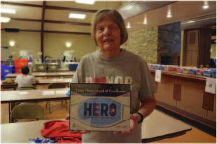 St. Michael's Hall blood drive coordinator Jane Poeppelman was recently honored by the Community Blood Center with the Crisis Hero Award.