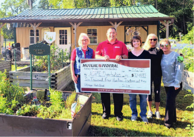 In early September, the People's Garden received a donation for a garden storage shed from Mutual Federal Bank by Eric Noble in the amount of $6,413.82. The Garden will be storing donated zero turn and push mowers given by Legion Baseball along with other donated gardening items. Pictured from left right is Conelia Dixon, master gardener; Eric Noble, Mutual Federal agent; Michelle Stephenson, garden coordinator; Debbie Grazioso and Rachel Wilson, skilled volunteers.