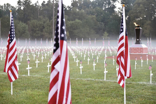 Fog hangs in the air behind the Field of Crosses at Veterans Memorial Field at 6 a.m. on Thursday, Sept. 16.