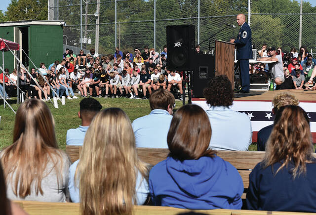 CMASF Steve O'Meara, of Sidney, speaks to local students during a service at the Traveling Vietnam Wall on Friday, Sept. 17.