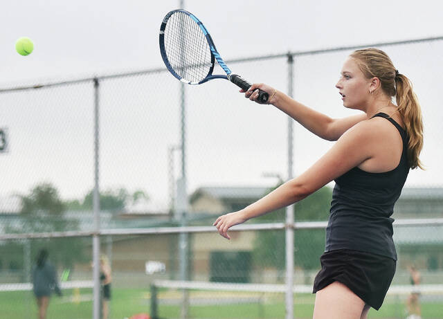 Sidney's Genna Grieshop swings during a Miami Valley League No. 3 singles crossover match against Tippecanoe on Tuesday in Sidney. Grieshop lost 6-0, 6-1.
