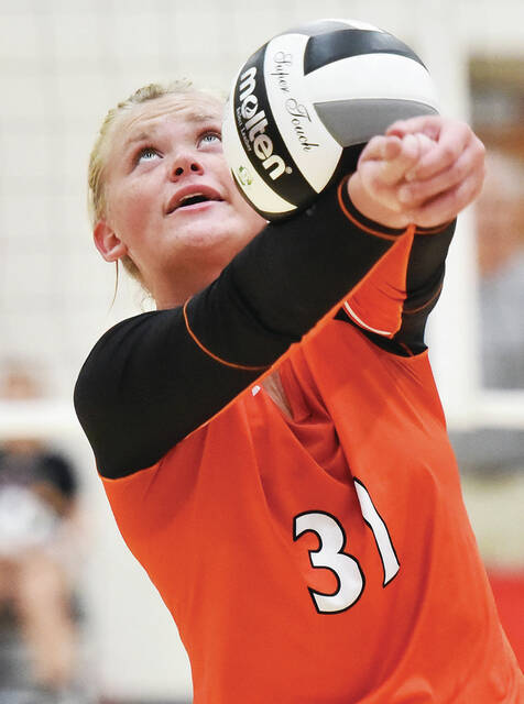 Jackson Center's Sarah Clark bumps during a nonconference game on Saturday in New Bremen. She had nine kills and nine digs in a 3-1 loss to the Cardinals.
