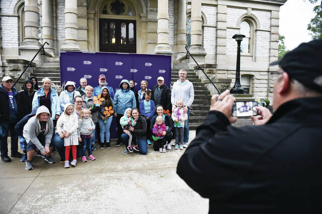 Miami Valley Alzheimer Association Executive Director Eric VanVlymen, of Dayton, takes a group photo of team June Bug at the 2021 Shelby County Walk to End Alzheimer's on Saturday, Sept. 25. Team June Bug was named for June Geis, of Botkins, who has Alzheimer's.
