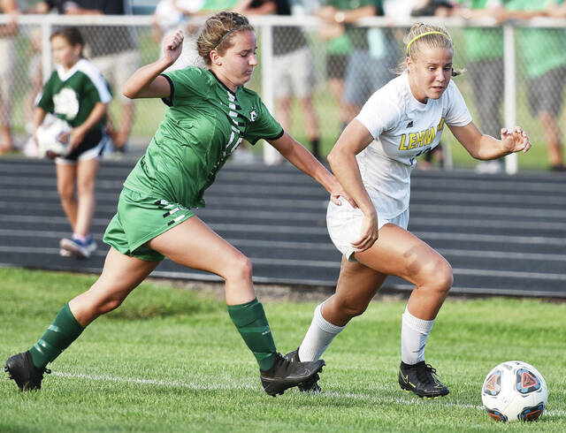 Lehman Catholic's Eva Dexter, right, dribbles ahead of Anna's Breelyn Berner during a nonconference game on Tuesday in Anna. Dexter has scored a team-high eight goals this season for the Cavaliers.