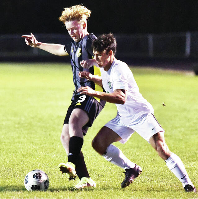 Sidney's Graham Van Tilburgh, left, keeps in front Northmont's Ty Treherne during a nonconference game on Saturday in Sidney. The Yellow Jackets lost 5-1.