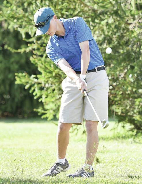Lehman Catholic's Noel Peterson swings during a Three Rivers Conference match on Thursday at Shelby Oaks Golf Club. Petersen led the Cavaliers with a 42.