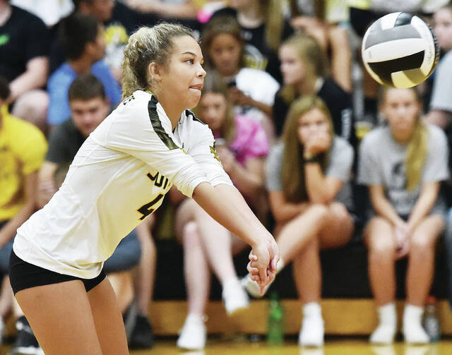 Sidney's Paris Williams-Clark bumps during a Miami Valley League crossover match on Tuesday in Sidney.