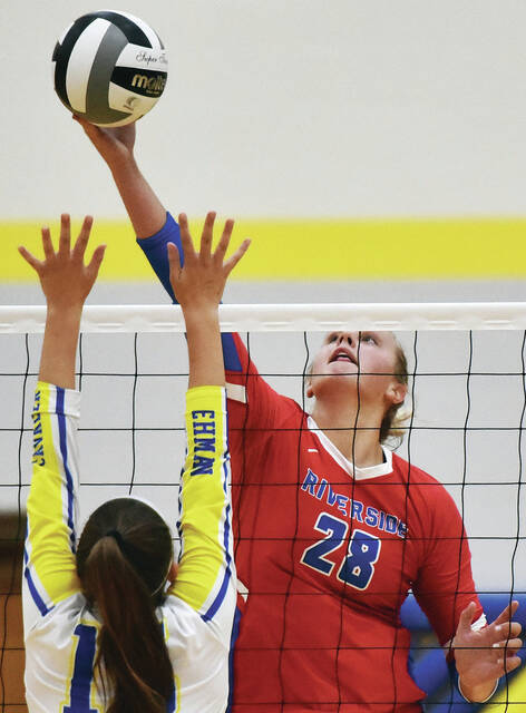 Riverside senior middle blocker Sasha Stotler spikes during a Three Rivers Conference match on Thursday at Schlater Family Gymnasium in Sidney. Stotler has returned after missing half her sophomore and all her junior seasons. She entered Thursday with 84 kills and 27 blocks to her credit this season.