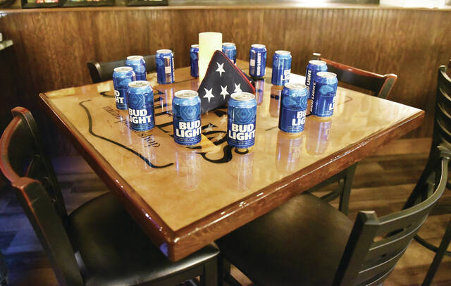 On Saturday, Aug. 28 Toni and Rob Thorne, owners of Amelio's, put 13 cans of beer and a U.S. flag on a table in their restaurant at the request of Shelby County Veterans Services Executive Director Chris North. Each beer was for one of the 13 U.S. service members killed during a suicide attack at the Hamid Karzai International Airport in Kabul, Afghanistan. The U.S. service members were working to evacuate people as the U.S. ended its 20 year war in Afghanistan. Eleven Marines, one Navy corpsman and one soldier were killed.
