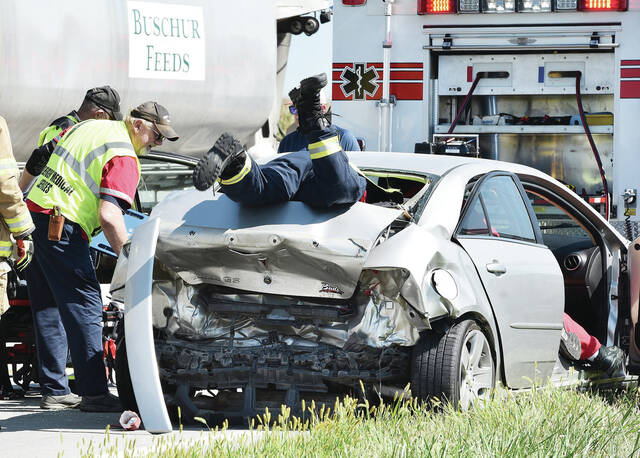 Fort Loramie Rescue workers and Fort Loramie firefighters work to remove the injured occupant of a car that was rear ended by a white minivan on state Route 29 at its intersection with Fort Loramie Swanders Road around 4:20 p.m. on Thursday, Sept. 2. Two people sustained non-life threatening injuries in the crash. The Shelby County Sheriff's Office is investigating the crash.