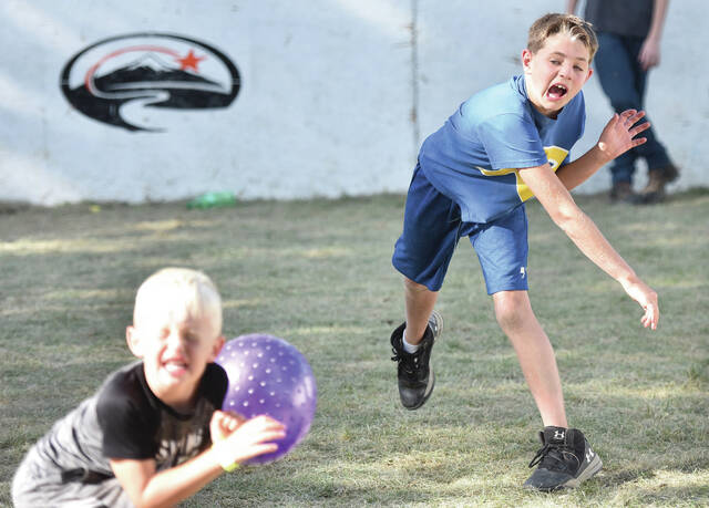 Malaki Schulze, right, 12, nails Kipton Cordonnier, 5, both of Russia, during a game of dodgeball at the 2021 Russia Homecoming Festival on Sunday, Sept. 5. Malaki is the son of Ryan and Tracy Schulze. Kipton is the son of Spencer and Amber Cordonnier.