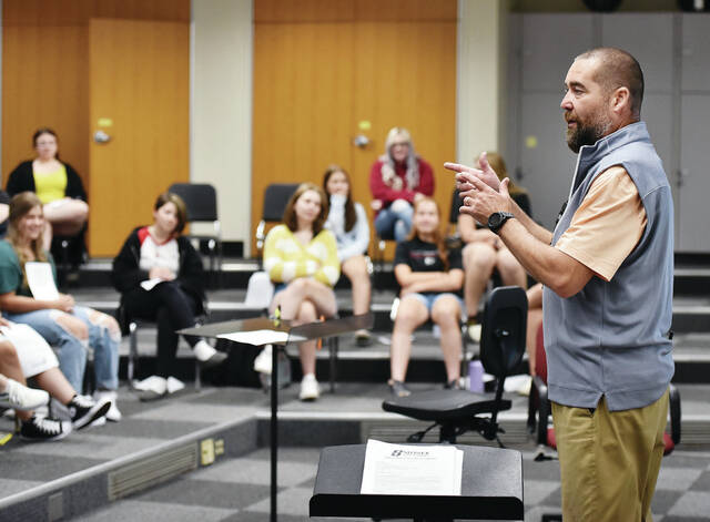 Sidney High School Band Director Chris Adams, of DeGraff, teaches a class on the first day of school on Tuesday, Sept. 7.