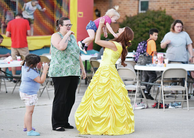 Attending the Northtowne Church of God's annual Kid's Carnival are, left to right, Calliope Kimbler, 6, her mom, Betsy Kimbler, Oaklynn Kimbler, 1, and her mom, Bethany Kimbler, all of Sidney. Bethany was dressed up as a princess for the event which featured an inflatable bounce house, free food and other activities on Wednesday, Sept. 8. Calliope is also the daughter of Danny Kimber. Oaklynn is also the daughter of Thomas Kimbler.
