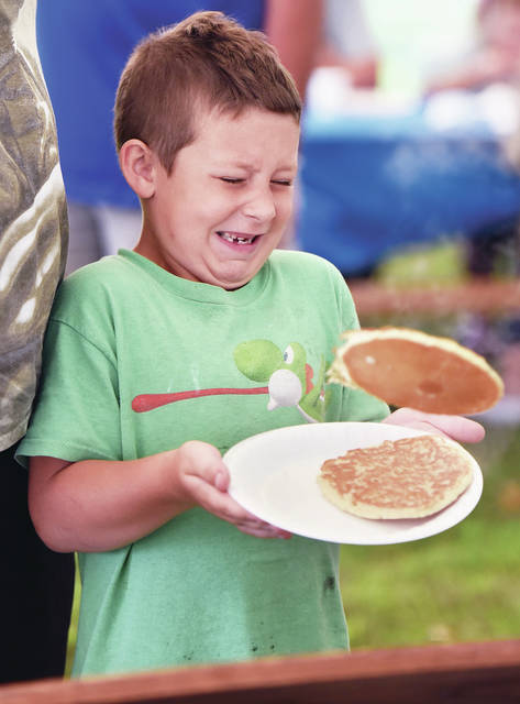 Jordan Green, of Sidney, son of Kylee and Jordan Green, flinches as he catches a pancake at the Sidney Rotary Club's annual Pancake Breakfast on the courtsquare in 2020. This year's all-you-can-eat pancakes and sausage meal will be held Sept. 11.