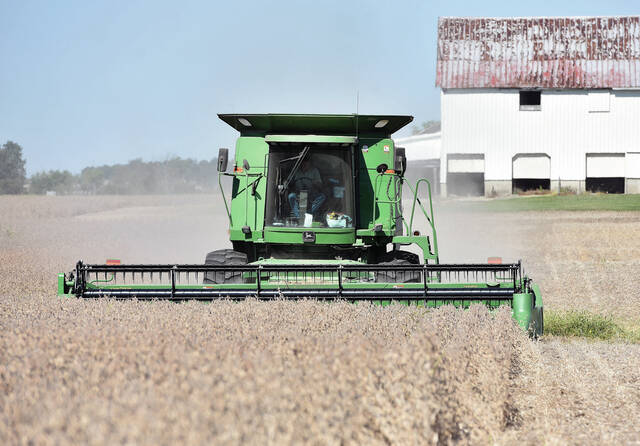 A combine harvests soy beans in a field along Cisco Road just east of Ohio Living Dorothy Love on Wednesday, Sept. 29.