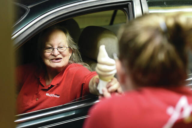 Janet Monger, left, buys a twist cone from Leann Gepfrey, both of Sidney, at Chilly Jilly's on Tuesday, Sept. 28. Chilly Jilly's will be closing for the season after Sunday, Oct. 17. When Chilly Jilly's closes Monger said she will get her ice cream fix at Dairy Queen.