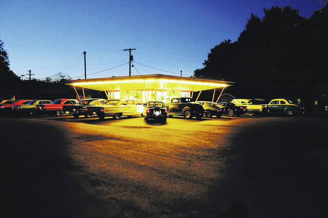 A local car group held a Friday evening cruise in at the BK Root Beer stand. Old vehicles of all types were highlighted by the lights at the root beer stand.