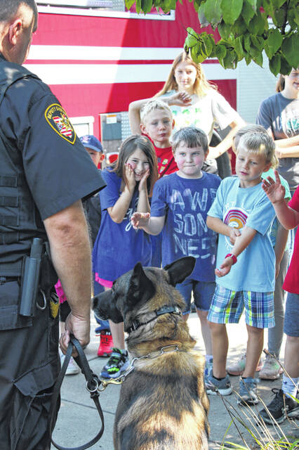Christian Academy Schools hosted the Sidney Police Department, Sidney Fire Department and Shelby County Sheriff's Office for lunch as part of their First Responder's Day. Dick Dray, head of school at CAS, invited the men and women to join the students for lunch and provided the meal. As a school this is one small way to say thank you to the men and women who sacrifice everyday for everyone's safety. Students from Miami, Shelby, and Auglaize County where able to ask questions, look at fire trucks, see inside the SWAT car and meet Bandit the K-9 deputy.
