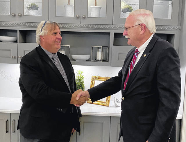 Sidney Mayor Mike Barhorst congratulates Bucyrus Law Director Rob Ratliff, who has been named to a federal immigration judgeship and notified City Council that he would not be accepting appointment as Sidney's next law director.