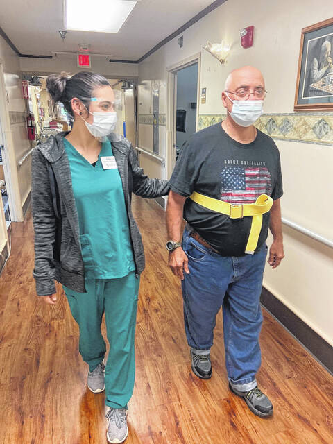 Randy Belt, 71, walks the hallway to help meet the goal for walking the World Trade towers. He is a US Marine Corp veteran.