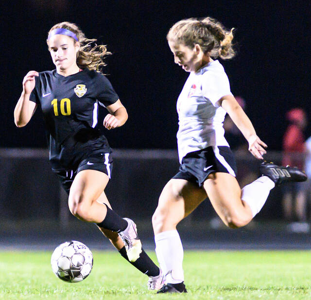 Sidney junior forward Lexee Brewer, left, chases after Tippecanoe's Maddie Chronister during the second half of a Miami Valley League game on Monday in Sidney. The Yellow Jackets lost the defacto MVL championship game 2-0.