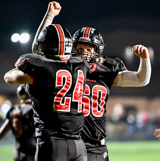 Fort Loramie's Taran Fleckenstein, right, celebrates with Jacob Sherman after Sherman scored a touchdown during a nonconference game on Friday at Redskin Stadium.