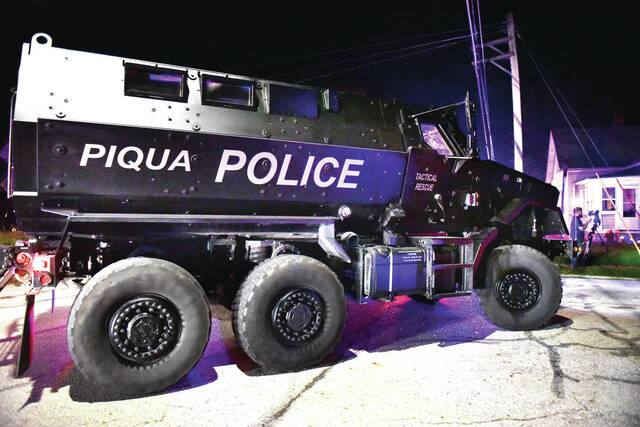 The Piqua tactical team arrives with their Mine-Resistant Ambush Protected, MRAP, vehicle during the search for a man who reportedly shot a Sidney police officer. The staging area was near Highland Avenue and Lynn Street on Wednesday, Oct. 6.