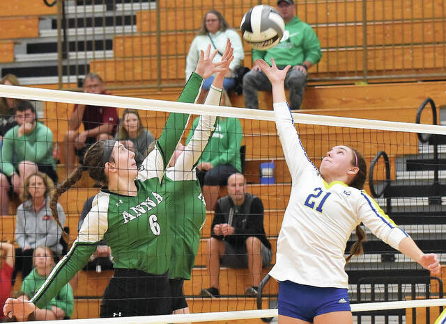 Anna's Molly Rioch blocks a spike from Lehman Catholic's Caroline Wesner during a nonconference volleyball match on Saturday at Schlater Family Gymnasium.