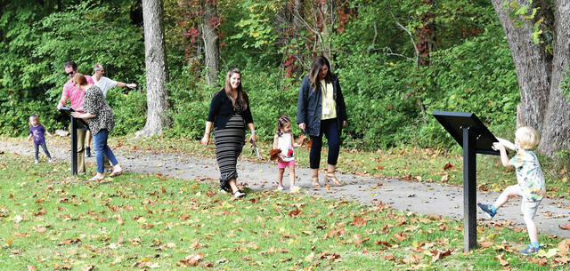 Parents and kids alike enjoy walking along the 1st Story Book Trail activity near the Geib Pavillion at Tawawa Park Wednesday, Oct. 6. The Story Book Walk event is planned to be held four times a year in conjunction with the coming of each new season.