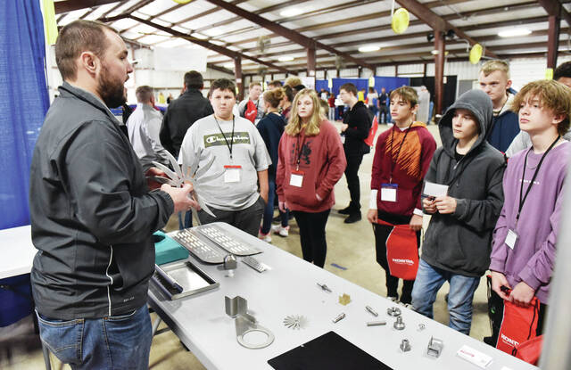 Engineer Jake Lochard, of Sidney, talks about how high pressured water is used to help cut shapes during a presentation at a Lochard, Inc. booth that was part of the 2021 Career Exploration Academy. The Academy was held by Workforce Partnership of Shelby County and Shelby County United Way at the Shelby County Fairgrounds on Thursday and Friday, Sept. 23 and 24.