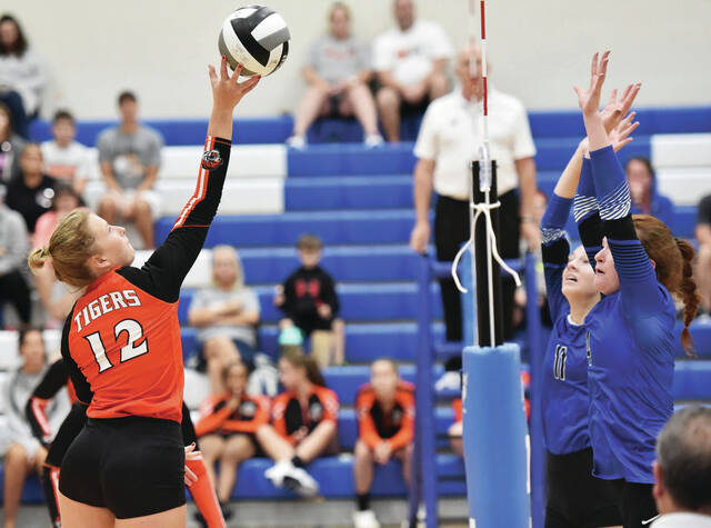 Jackson Center's Elena Platfoot, left to right, puts the ball up as Fairlawn's Ellie Henman and Jessie Abke defend at Fairlawn on Thursday.