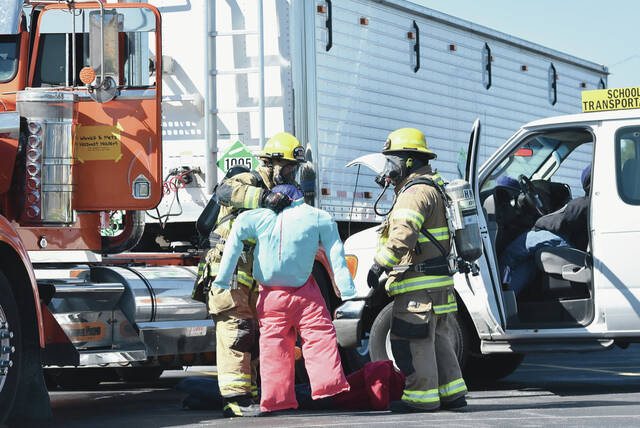 Sidney firefighters rescue people from a toxic leak during a disaster training exercise at Airstream in Jackson Center on Friday, Oct. 1.