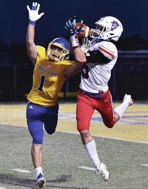Riverside's Deven Frilling hauls in a pass while covered by Lehman Catholic's Seth Knapke during a Three Rivers Conference game on Friday at Sidney Memorial Stadium. Frilling caught eight passes for 123 yards and one TD.