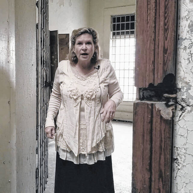 Last year COVID protocols prevented the historical society from having its traditional Downtown Ghost Tour and they didn't want to disappoint anyone by not doing anything, so they went on line with a few stories. Pictured is Julie Gilardi portraying Emma Purkepile at the Shelby County Jail during the Digital 2020 Downtown Ghost Tour.