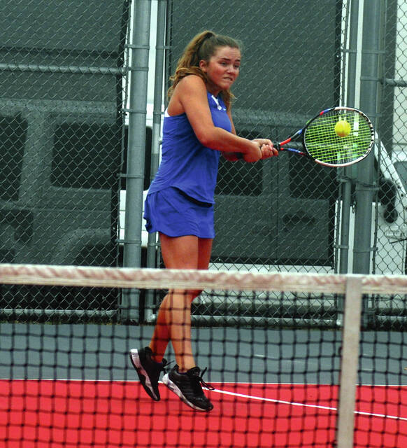 Lehman Catholic's Macie Verdier hits a backhand return during the Division II sectional tournament on Tuesday at Troy High School.