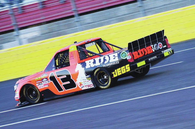 Cody Coughlin drives his truck on a paved track.