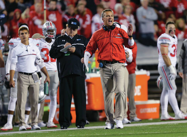 Ohio State coach Urban Meyer disputes a call during the first half of the team's NCAA college football game against Wisconsin on Saturday, Oct. 15, 2016, in Madison, Wis.