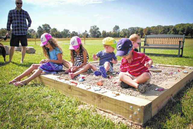 The Born Learning Trails of the park were created by United Way so children can experience nature hands on. Children were drawn to the large box of sand and rocks where they could dig to find hand painted rocks with wonderful designs that will help them about nature with their parents.