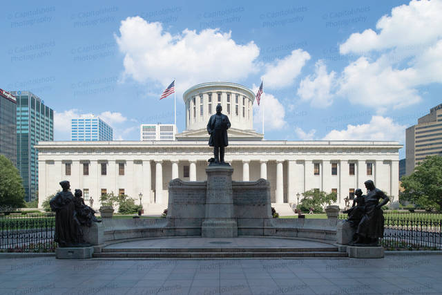 An image of the Ohio Statehouse.  In the foreground stands the McKinley Monument, designed by H.A. MacNeil, erected in 1906 and honoring honors William McKinley, former Ohio governor and U.S. president.  The Greek Revival building was constructed between 1839 and 1961.  The Ohio Statehouse, located in Columbus and serving as the Ohio state capitol, is a National Historic Landmark.  This image  Capitolshots Photography, ALL RIGHTS RESERVED.