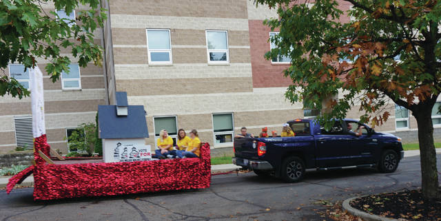 The Big Walnut Homecoming Parade features floats from each school building in the district, and they finish at the High School parking lot. This float was in support of the upcoming bond issue.