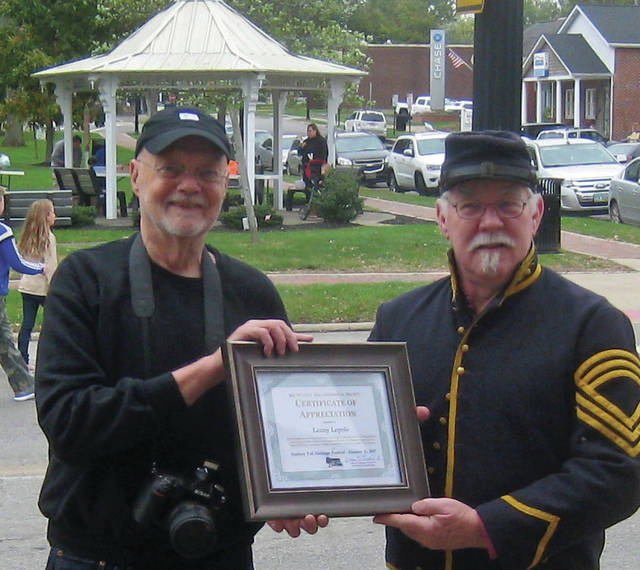 Bill Comisford, president of the Big Walnut Area Historical Society, presents the Volunteer Recognition award to Lenny Lepola (left) on Sunday Oct. 15 at the Sunbury Fall Heritage Festival.