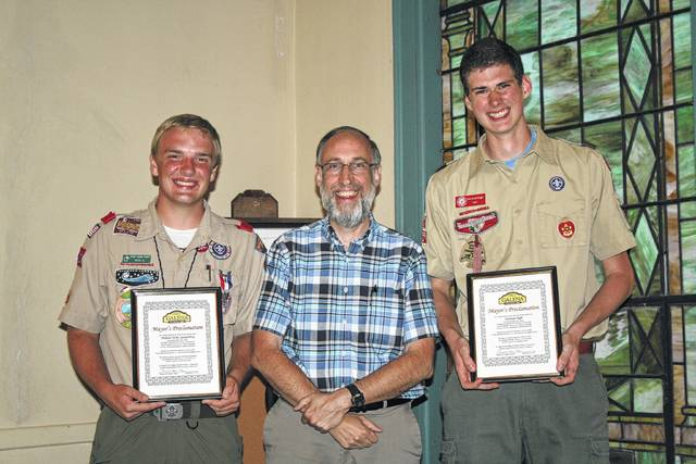 Mayor Thomas Hopper, center, recognized local Eagle Scouts Nicholas Spangenberg (left) and Donovan Pugh (right) with Mayor's Proclamations.