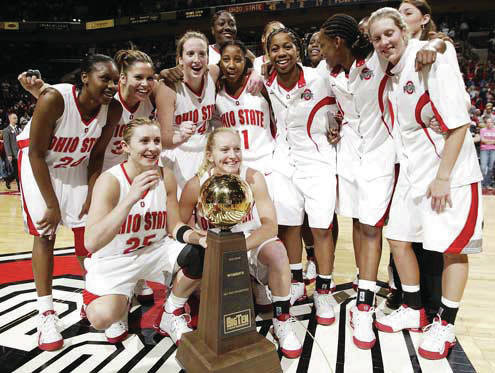The Lady Bucks celebrate in this file photo.