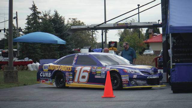 A NASCAR automobile sits in the parking lot of the NAPA auto parts dealership along Sunbury Road on Friday, Sept. 29. The car was there as part of a promotion that featured hamburgers on the grill, and plenty of customers had their fill on a beautiful fall day.