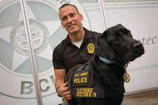 BCI Special Agent Josh Rammel and K-9 Reptar.