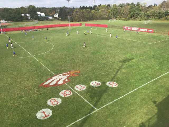 An overhead look at the soccer field during a game from atop the football stadium's home bleachers.
