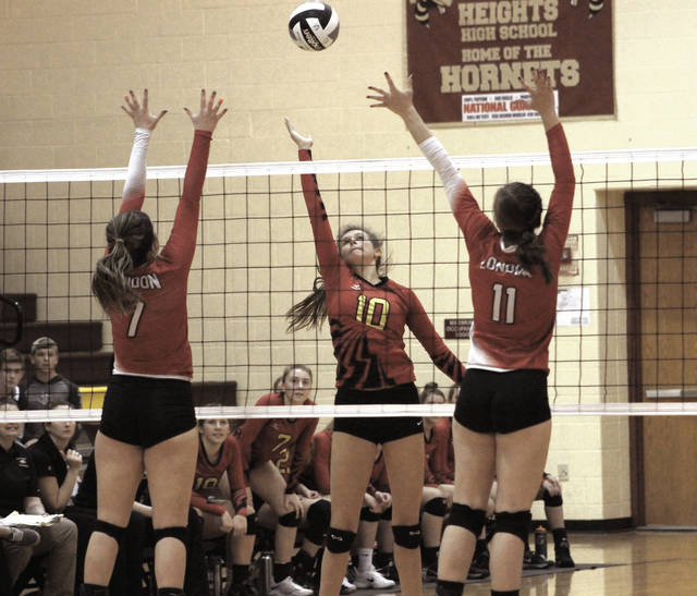 Big Walnut's Machaela Podraza (10) lofts a shot over the outstretched arms of London's Malorie Colwell (7) and Ryleigh Bexfield (11) during Saturday's Division II district championship at Licking Heights High School.