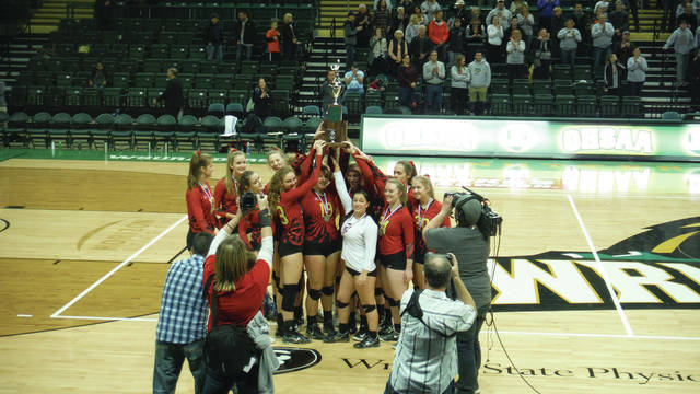 The Big Walnut Girls Varsity Volleyball team hoists the Division II runner-up trophy after a straight-set loss to Padua in the Nutter Center on Nov. 11.