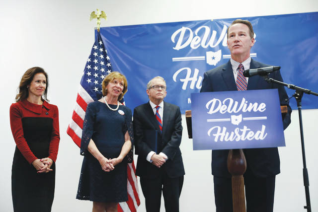 Ohio Secretary of State Jon Husted, right, speaks alongside, Ohio Attorney General and former U.S. Sen. Mike DeWine, center right, Fran DeWine, center left, and Tina Husted, left, during a news conference at the University of Dayton to announce their decision to share the ticket in their bid for the Ohio governorship on Thursday in Dayton.