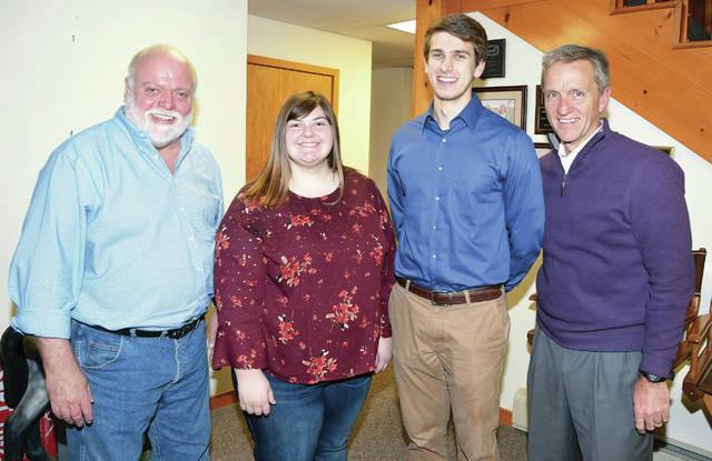 Pictured from left to right are Don Howard, Delaware County Agricultural Society Board President; scholarship recipients Trinity Smith and Jacob Wenner; and Tom Wright, DCAS Board Vice President.
